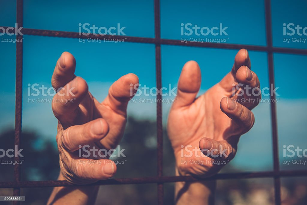 Hands of Migrants at the Border, Hand Gestures stock photo