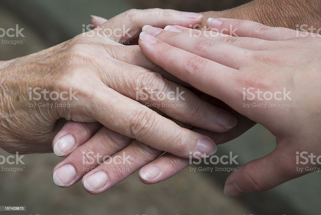 Hands of Mother, Daughter and Grandmother stock photo
