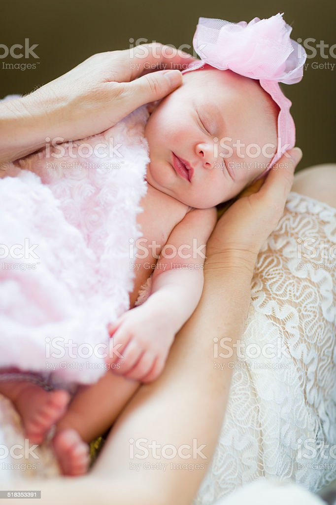 Hands of Mother Holding Her Newborn Baby Girl stock photo