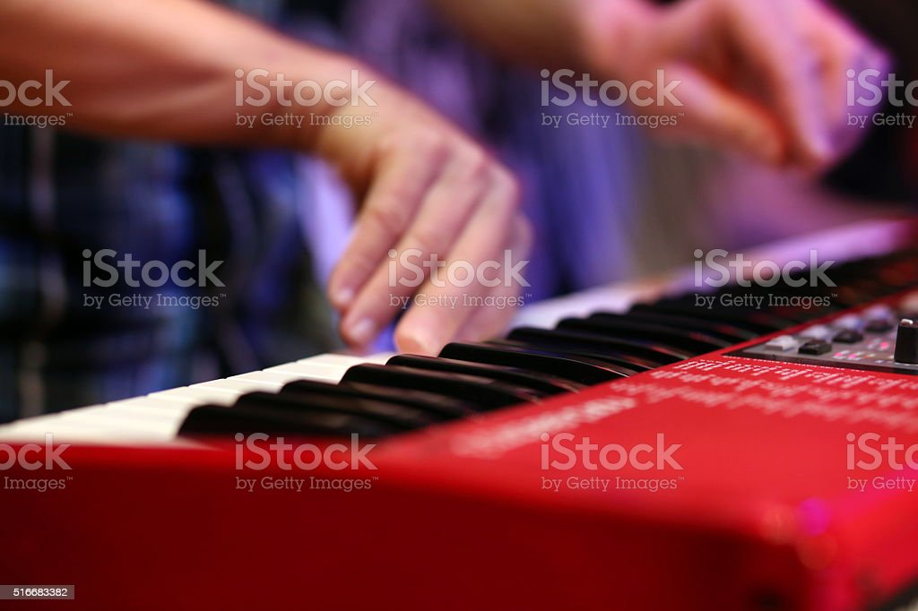 hands of musician playing keyboard stock photo