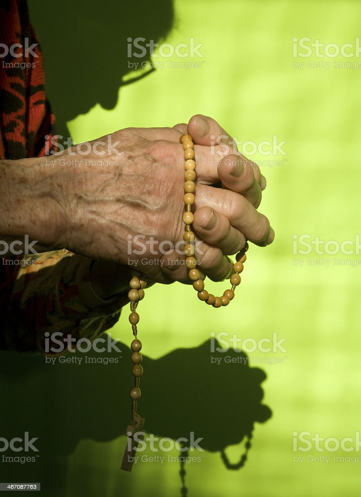 hands of old woman at prayer royalty-free stock photo