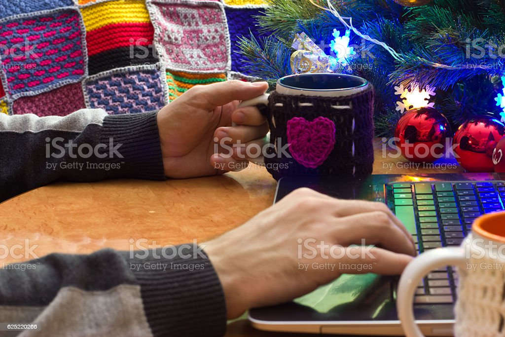 Hands of people at a laptop. stock photo