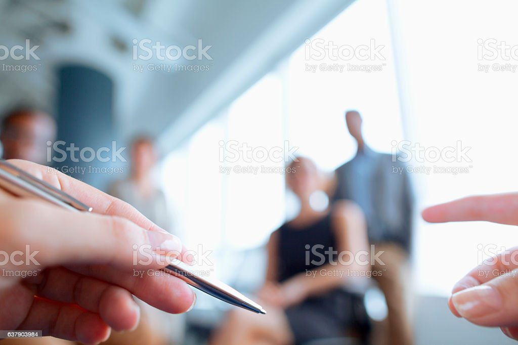 Hands of person talking during business meeting in office stock photo