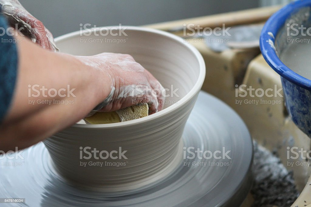 hands of potter creating ceramic on the circle stock photo