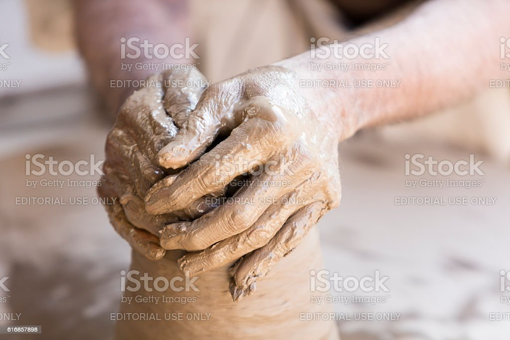 Hands of potter making clay pot, Rajasthan, India stock photo
