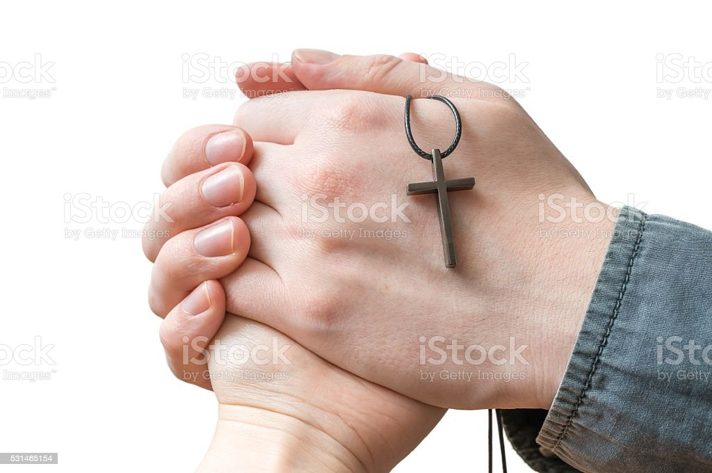 Hands of priest blessing woman isolated on white background. stock photo