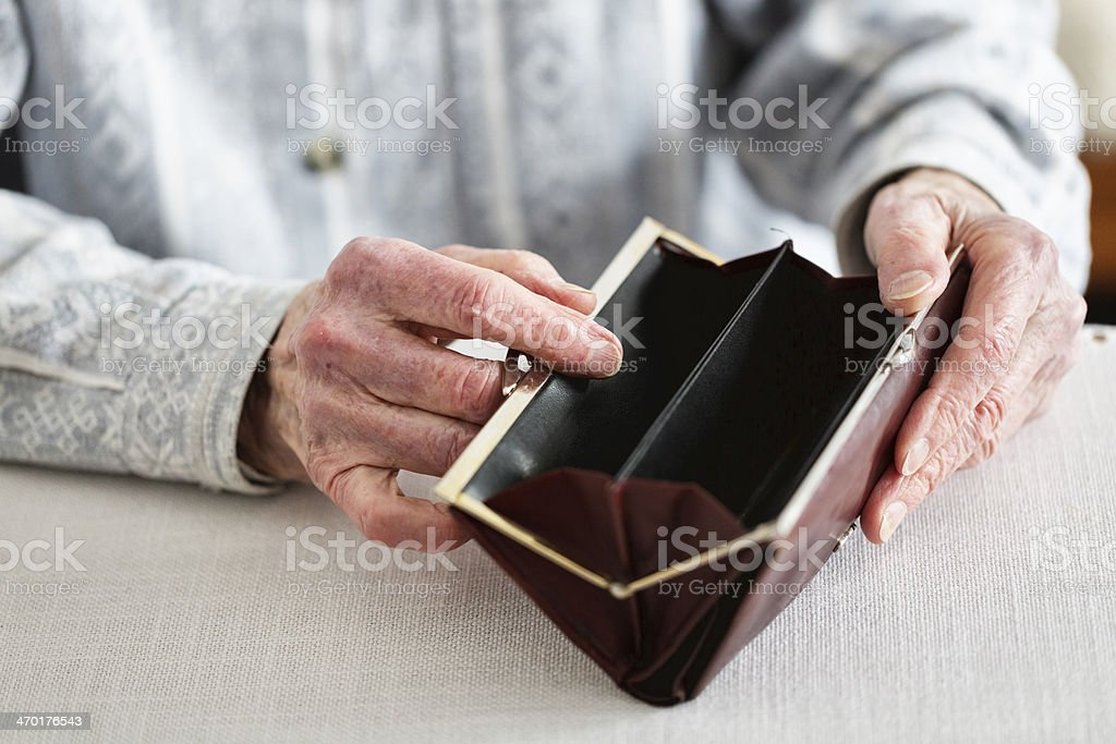hands of senior adult holding empty purse stock photo