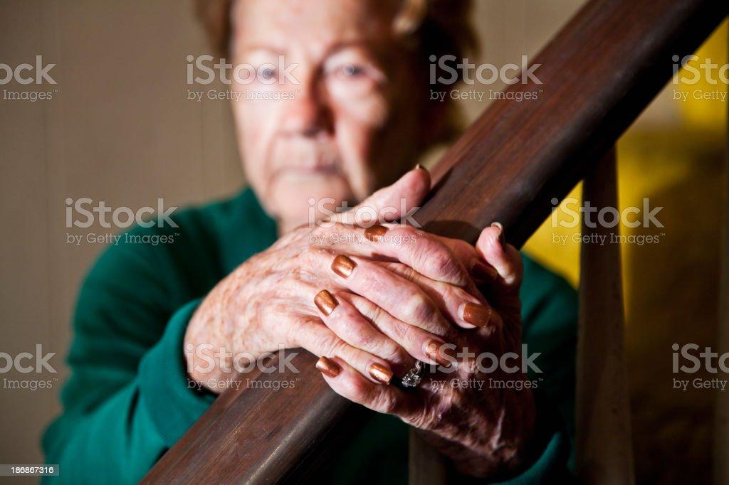 Hands of senior woman holding banister stock photo