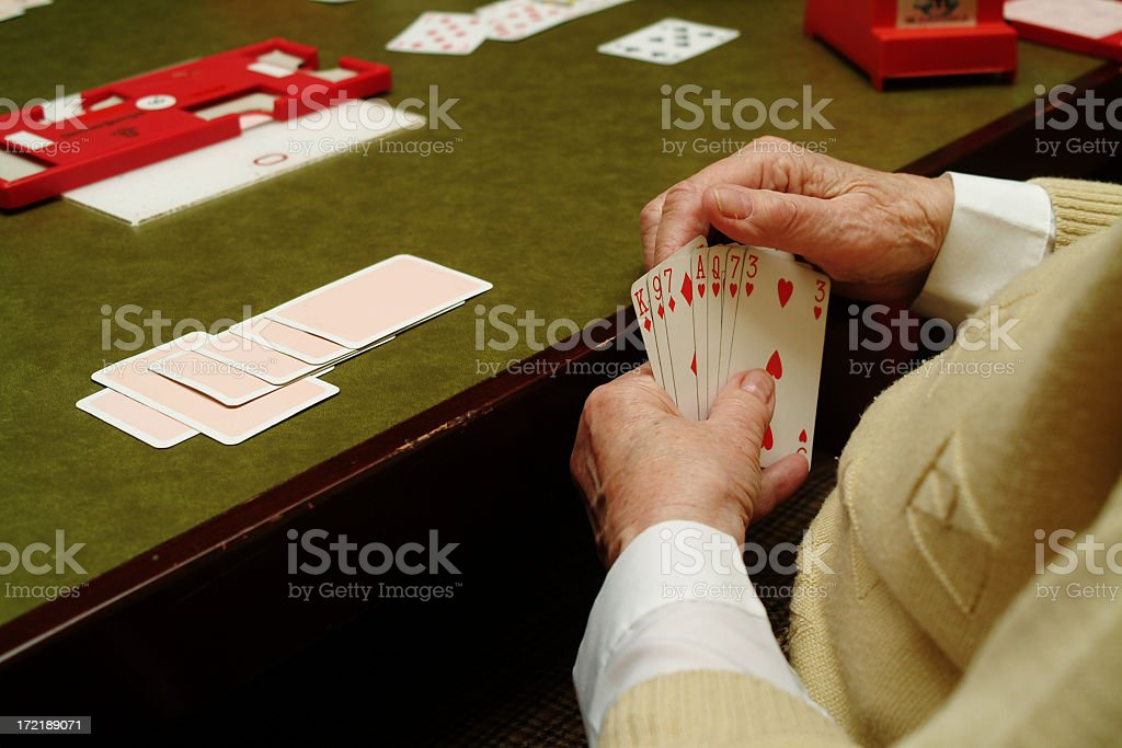 Hands of senior woman Playing Cards stock photo