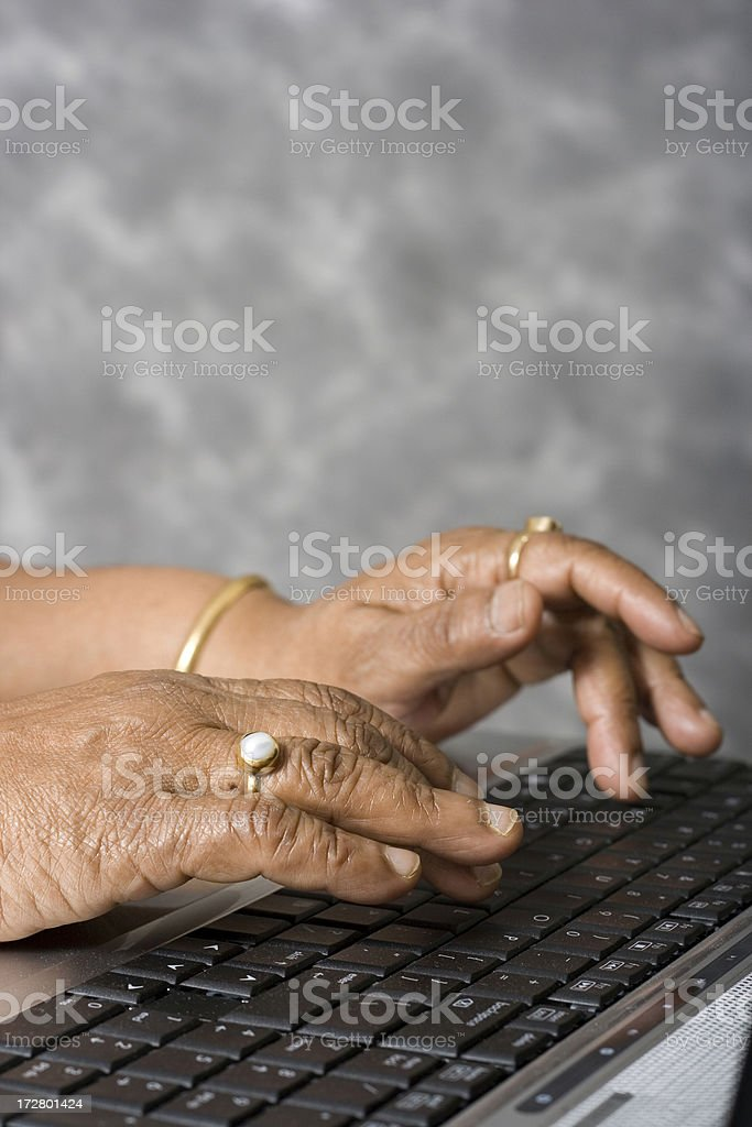 Hands of senior woman working on Laptop royalty-free stock photo