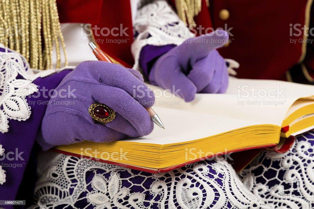 hands of sinterklaas with book stock photo
