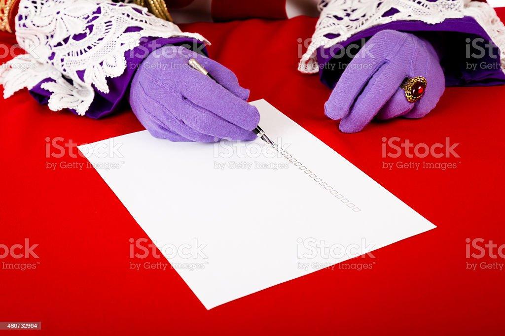 Hands of sinterklaas with empty check list stock photo
