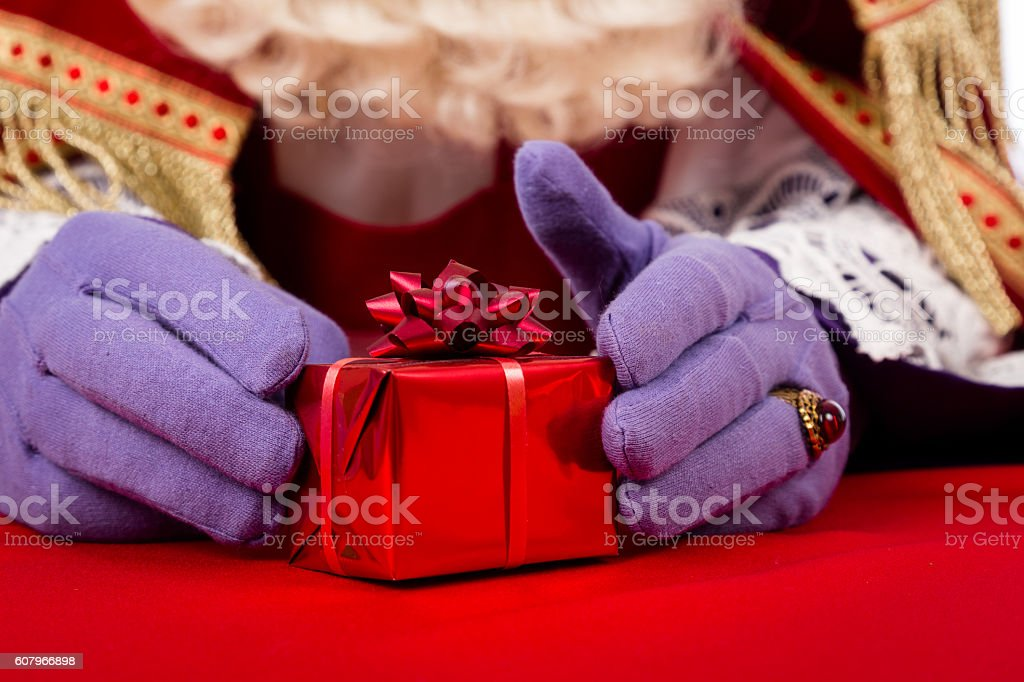 Hands of Sinterklaas with present stock photo
