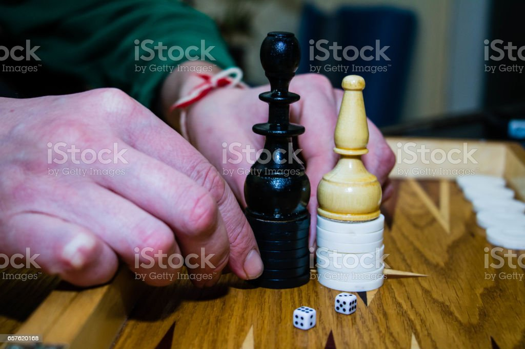 hands of the board game backgammon chess stock photo