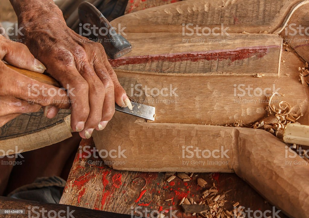hands of the craftsman carve stock photo