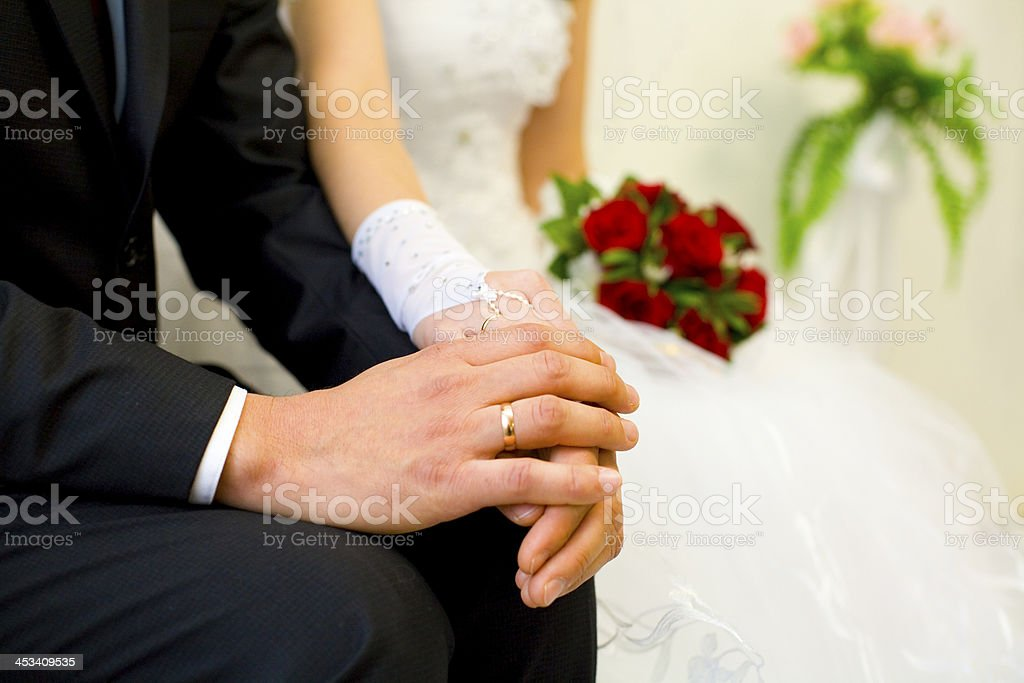 Hands of the groom and bride close up royalty-free stock photo