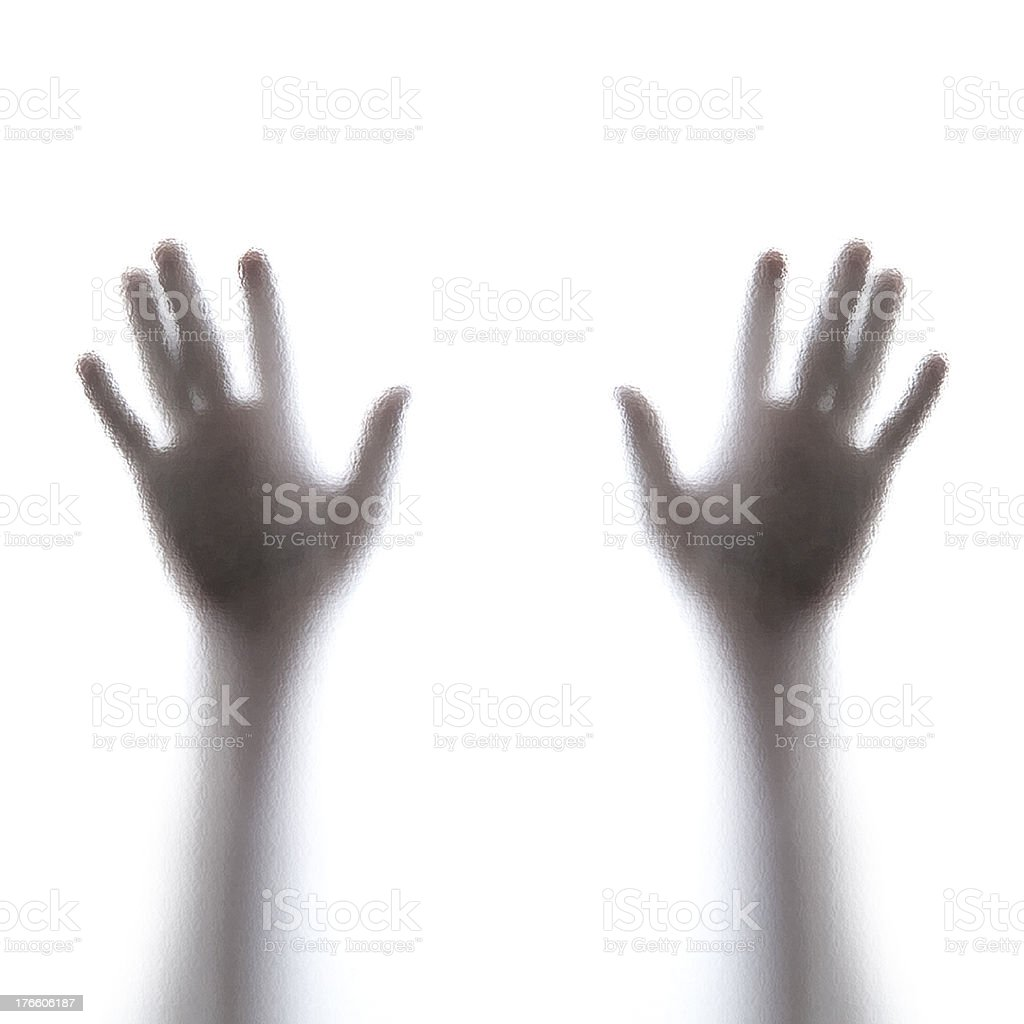 Hands of the Man behind frosted glass royalty-free stock photo