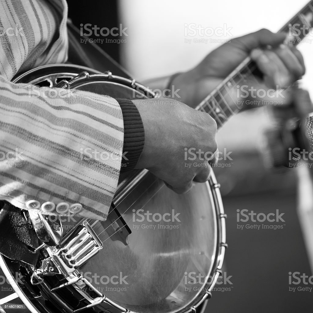 Hands of the man playing the banjo stock photo