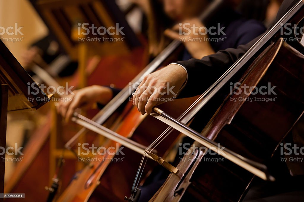Hands of the man playing the cello stock photo