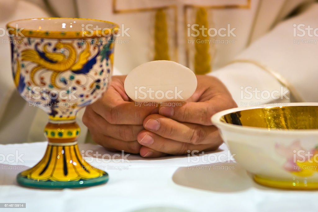 hands of the pope celebrated the Eucharist stock photo