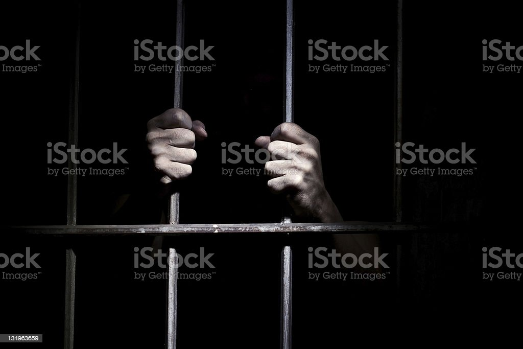 Hands of the prisoner stock photo
