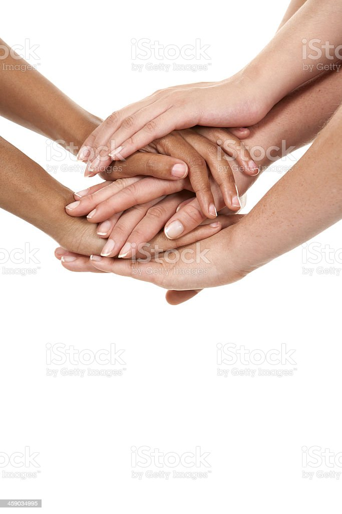 Hands of various skin color stacked on top of each other stock photo