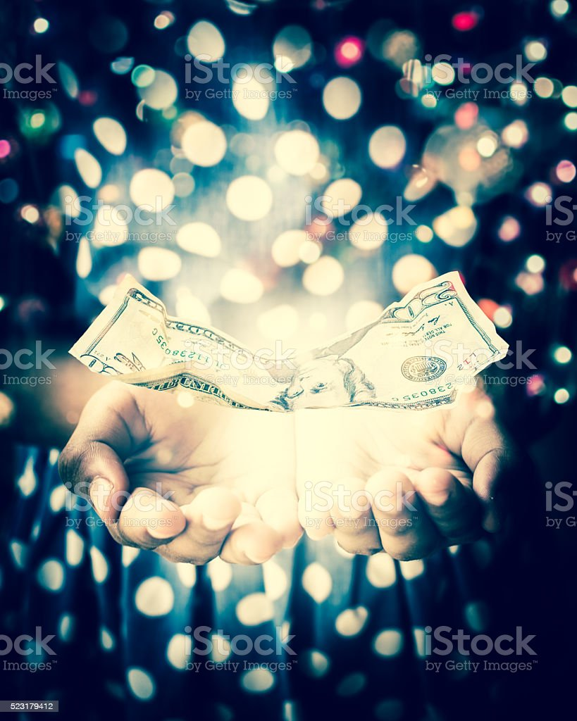 Hands of witch in a dark room conjuring a spell stock photo