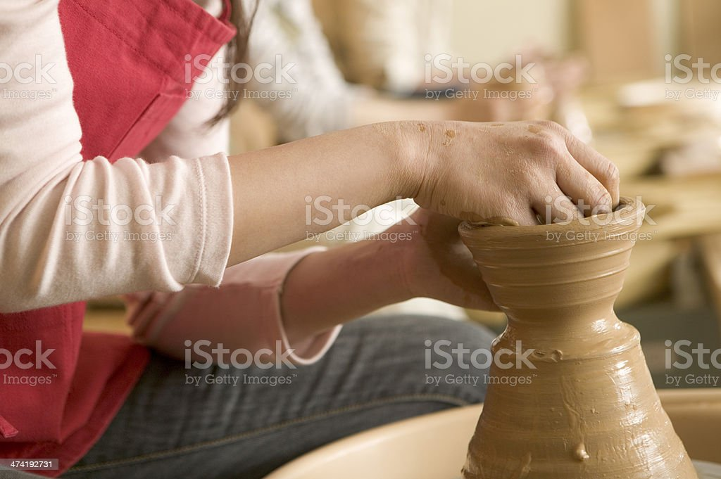 Hands of woman turning pottery wheel stock photo