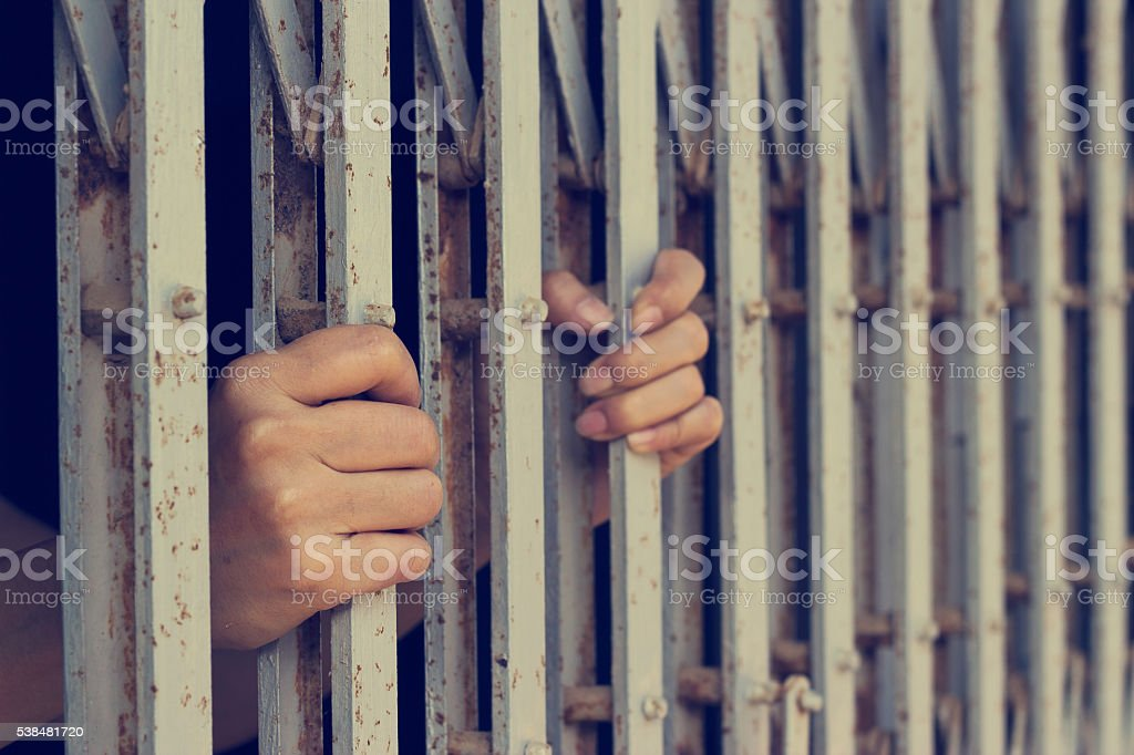 hands of woman who was imprisoned stock photo