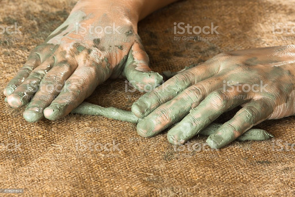 hands of women working with clay, closeup stock photo