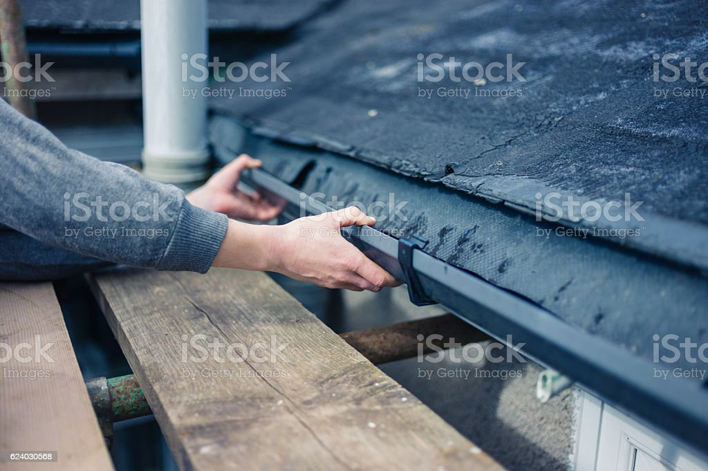 Hands of worker fixing drain stock photo
