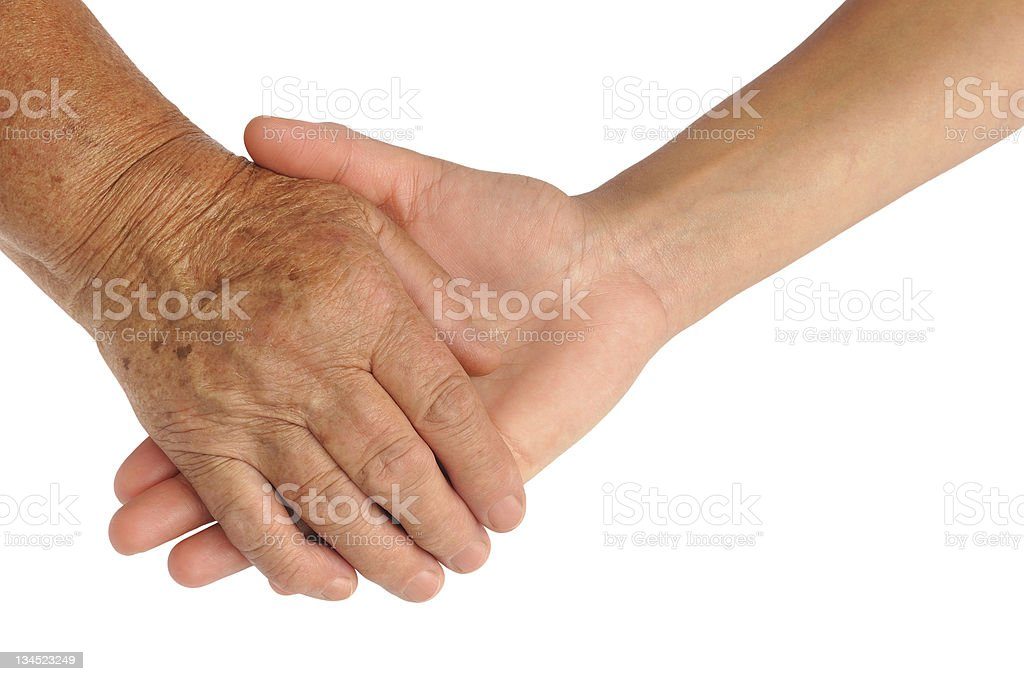 Hands of young and senior women - helping hand concept royalty-free stock photo