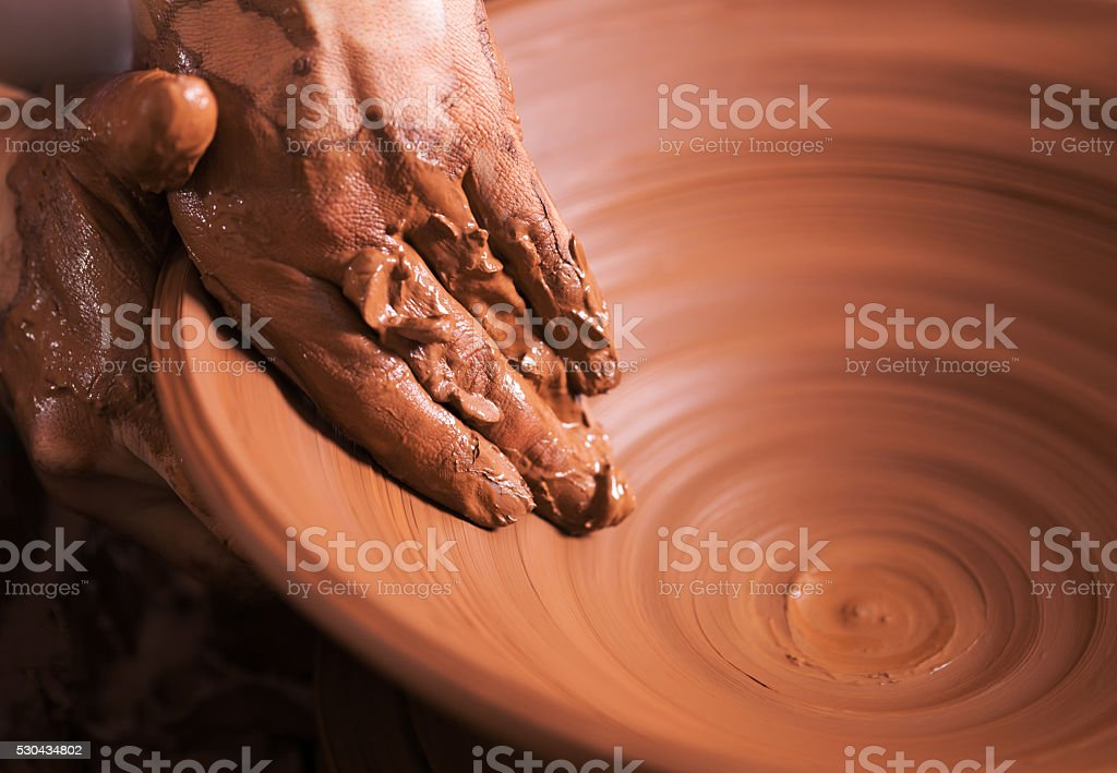 Hands of young potter, was produced on range of pot. stock photo