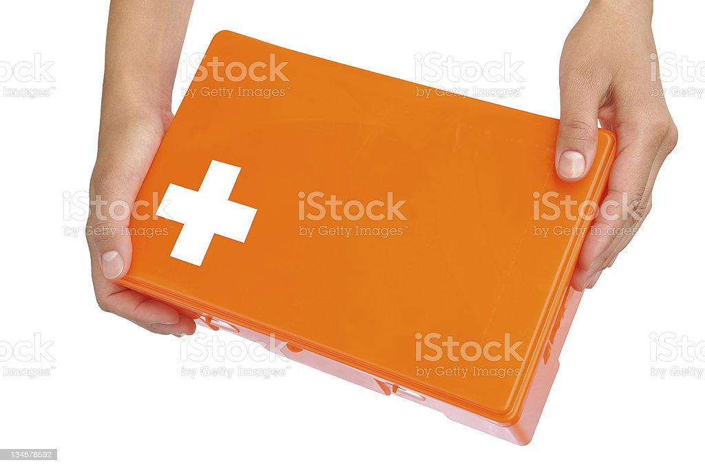 Hands of young woman holding first aid kit royalty-free stock photo