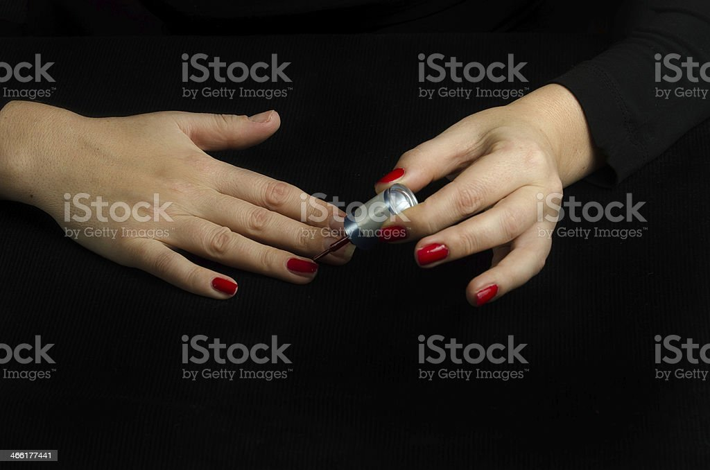 Hands of Young Woman Making Manicure royalty-free stock photo