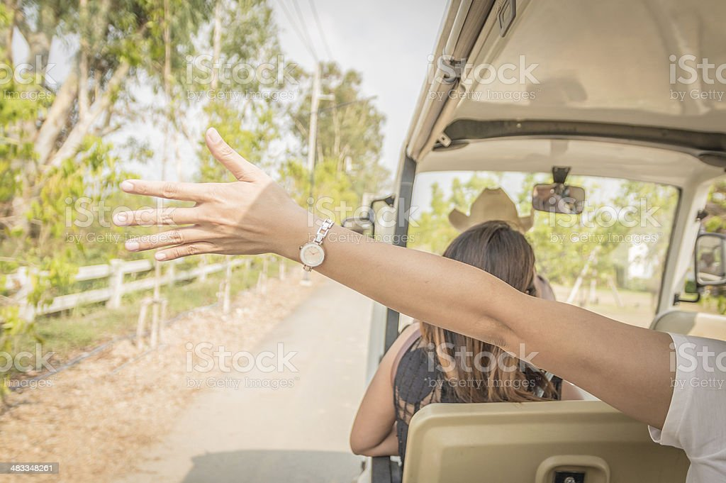 Hands of young woman on the golf cart. stock photo
