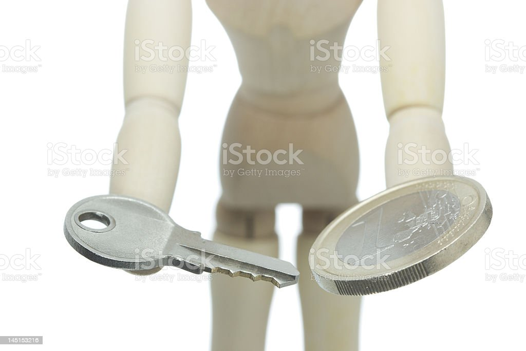 Hands offer key and money royalty-free stock photo