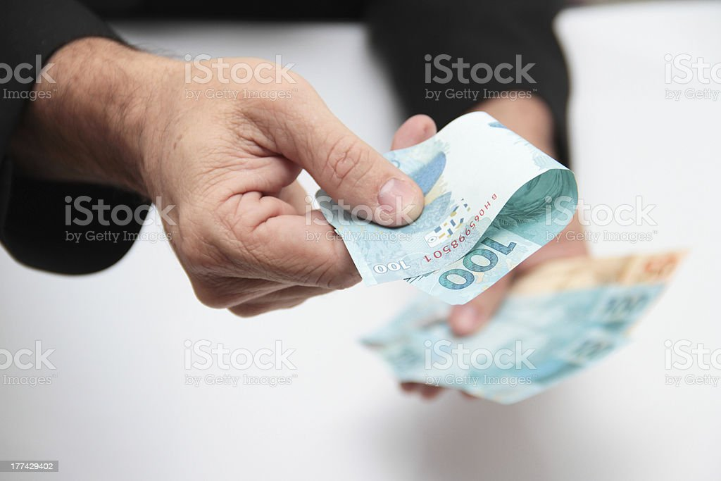 Hands offering money stock photo