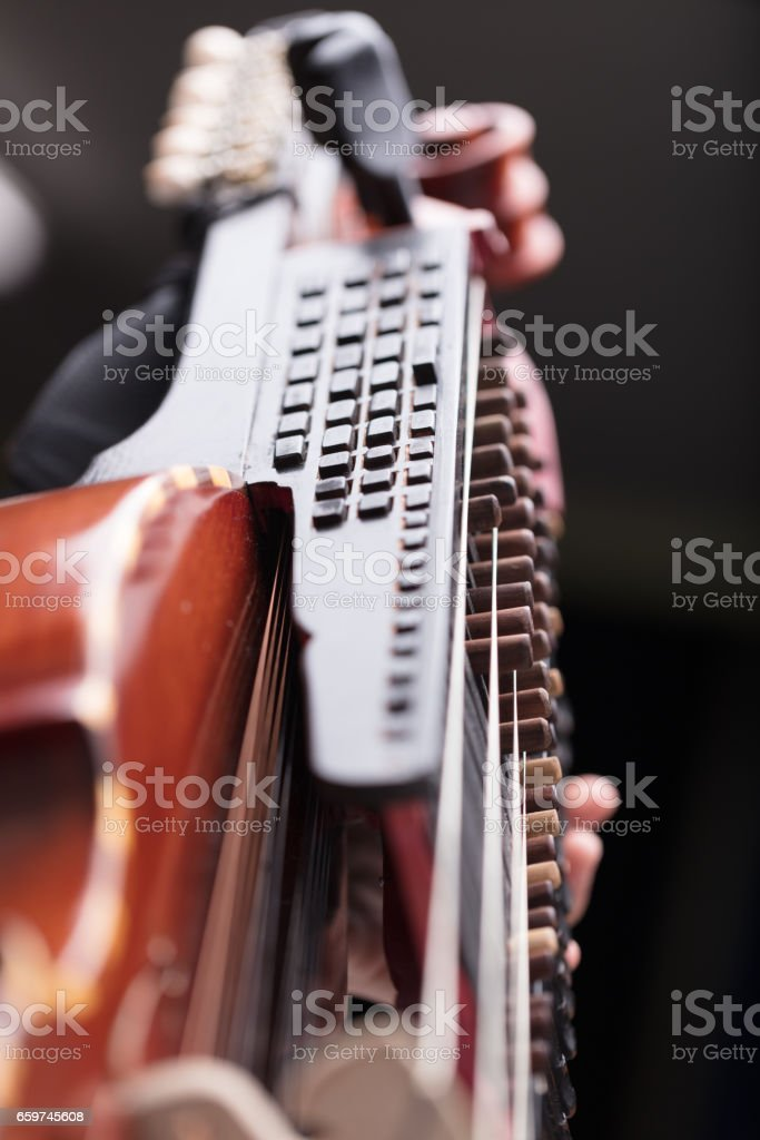 hands on a Baroque musical instrument stock photo
