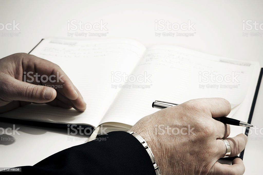 Hands on a Book stock photo