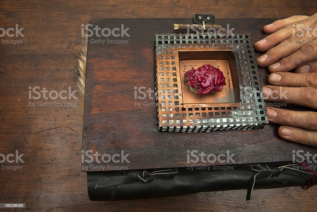 Hands on a strange book royalty-free stock photo