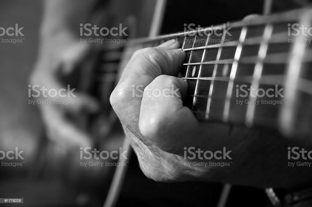 Hands on Acoustic Guitar stock photo
