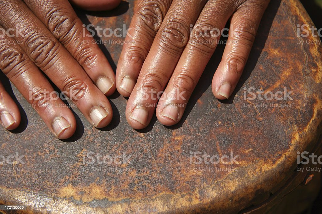 Hands on an Old Drum five royalty-free stock photo