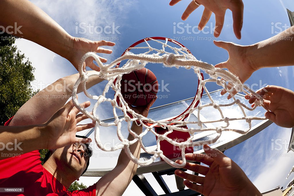 Hands on basketball goal. Sports. Playing. Directly below. Team. stock photo