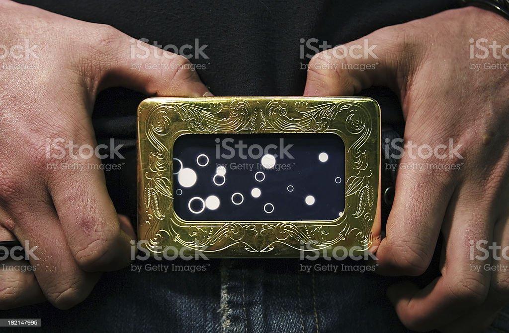 hands on belt buckle stock photo