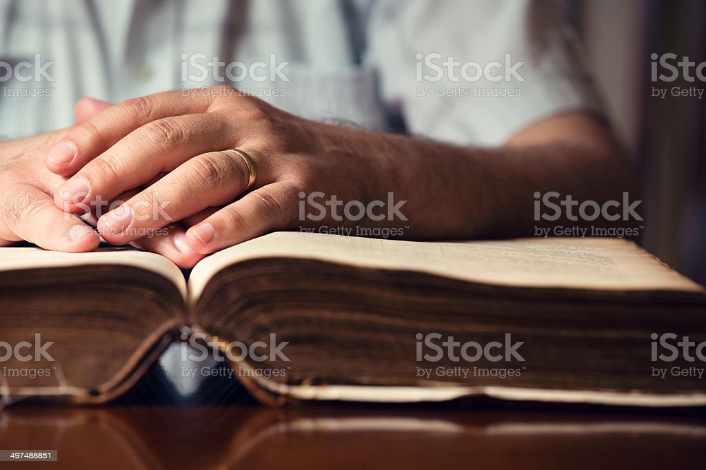 Hands On Bible stock photo