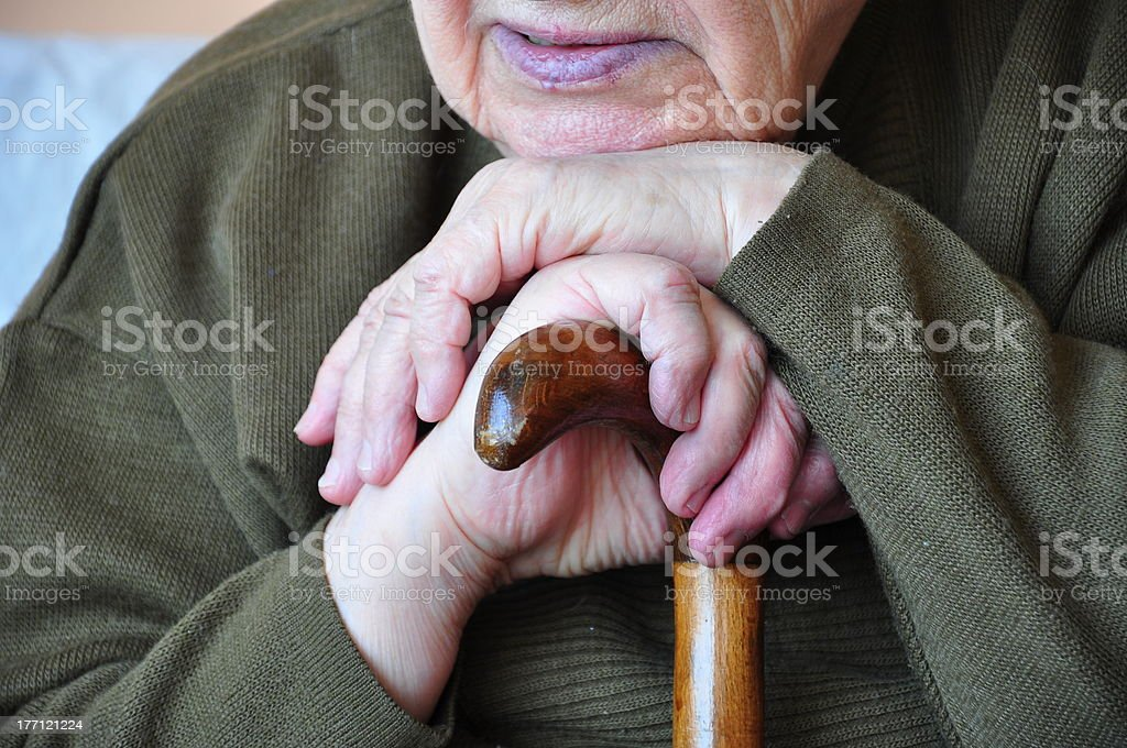 hands on cane stock photo