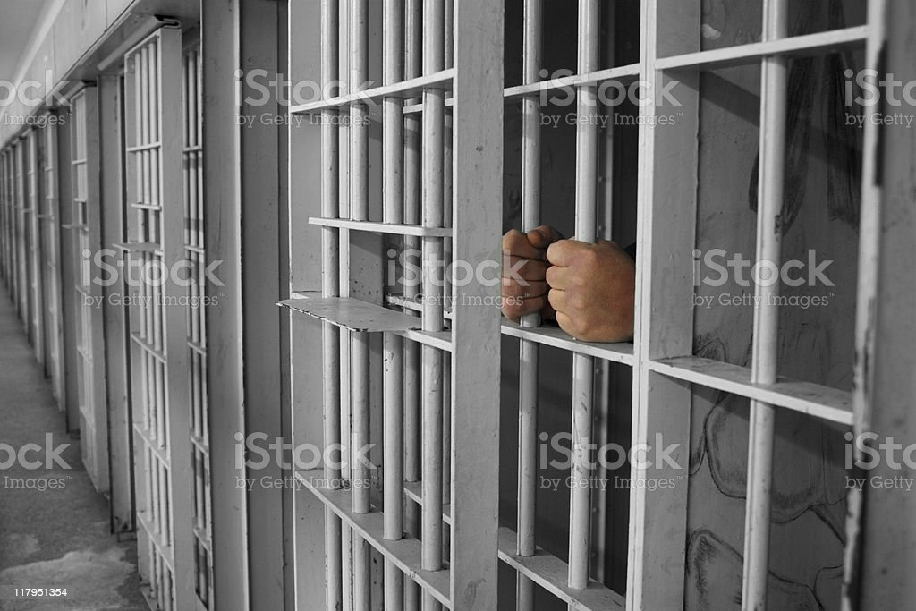 Hands on Cell bars royalty-free stock photo