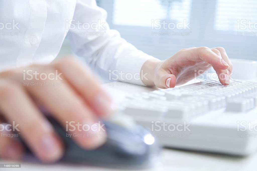 hands on computer keyboard stock photo