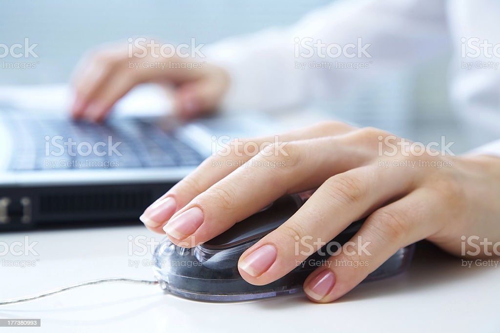 hands on computer mouse and keyboard stock photo